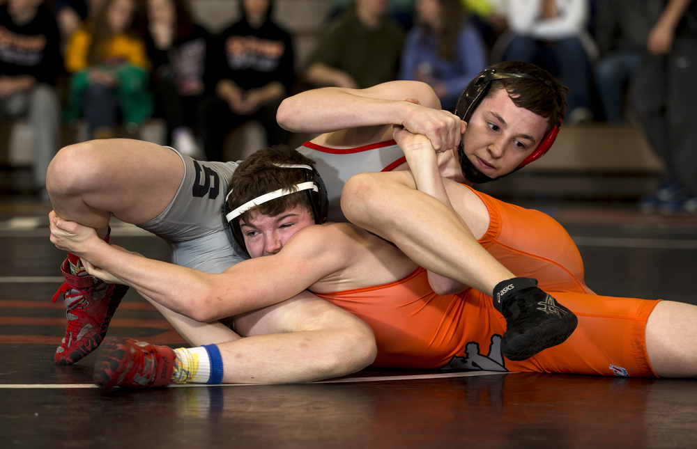Lanphier's Cody Wheeler tries to find a way to escape the grasp of Springfield's Dalton Kinison in the 113-pound championship match during the IHSA Class 2A Springfield Regional at Willard Duey Gymnasium, Saturday, Feb. 6, 2016, in Springfield, Ill. Justin L. Fowler/The State Journal-Register