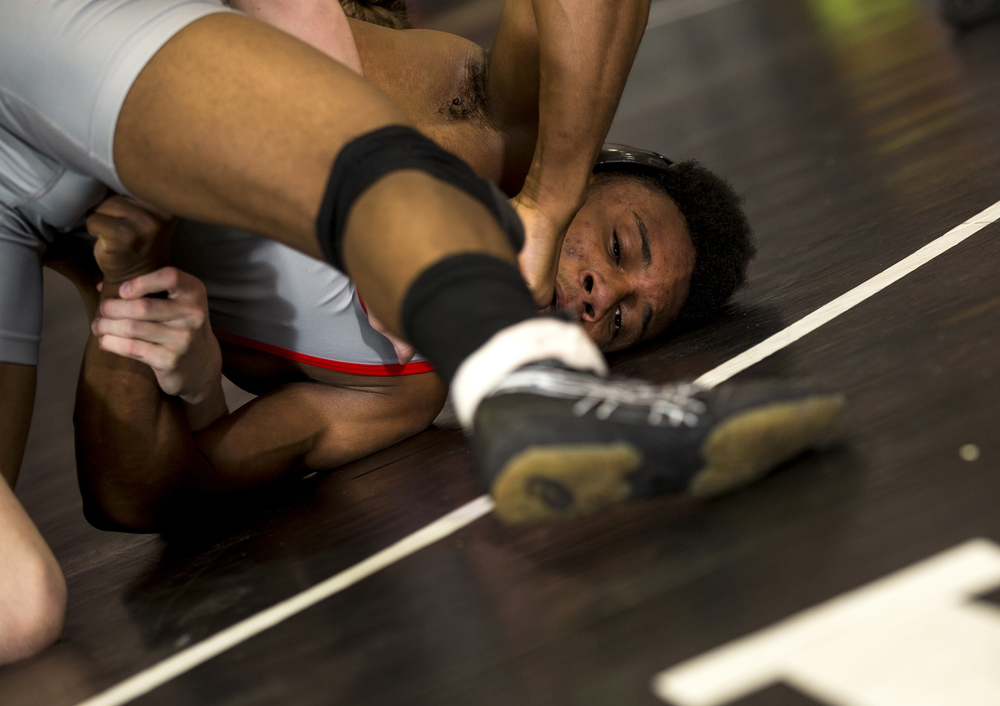 Springfield's Dajuan Stewart tries to escape the grasp of Riverton's Noah Foreman in the 132-pound championship match during the IHSA Class 2A Springfield Regional at Willard Duey Gymnasium, Saturday, Feb. 6, 2016, in Springfield, Ill. Justin L. Fowler/The State Journal-Register