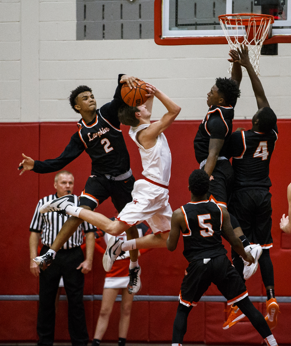 Lanphier's Cardell McGee (2) is called for a foul while trying to block a shot form Glenwood's Matt Bahlmann (4) in the third quarter at Glenwood High School, Friday, Feb. 5, 2016, in Chatham, Ill. Justin L. Fowler/The State Journal-Register