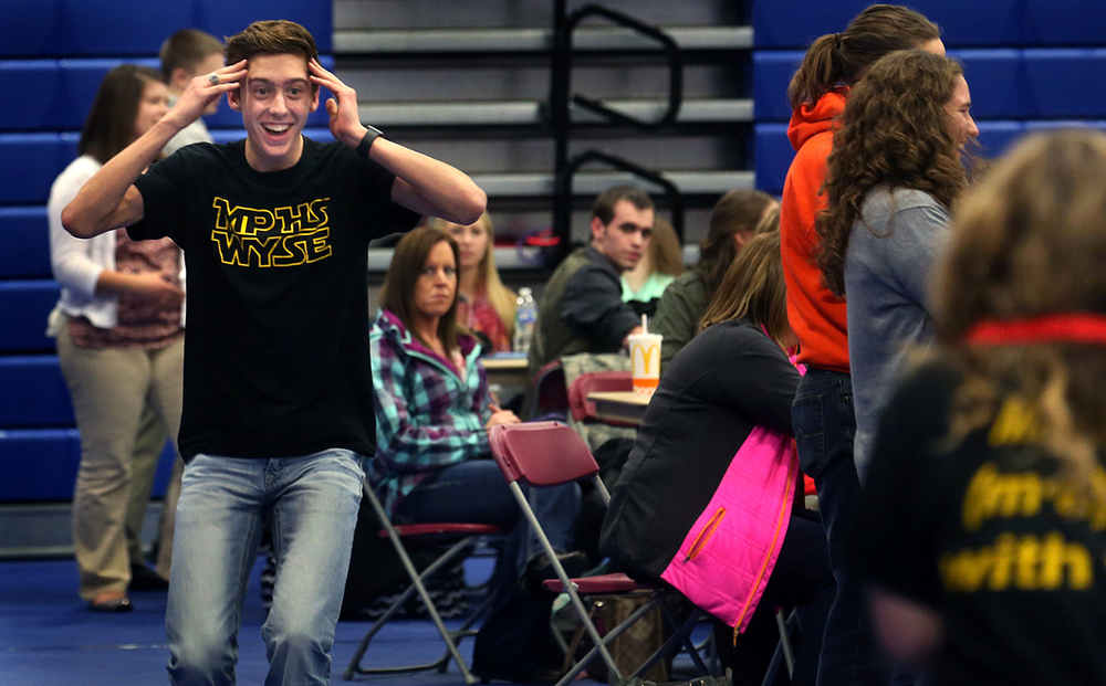Mt. Pulaski High School student Eli Olson reacts to fellow classmate Miranda Hilliard who approaches at far right after he learned he had tied Hilliard for first place in the computer science category of the WYSE Challenge for 300 level schools. Olson was in route to picking up his medal. Their classmate Emaleigh Beiry also came in second overall in the category. Regional level competition featuring approximately 360 students from 22 area high schools competed in the annual Worldwide Youth in Science and Engineering (WYSE) Academic Challenge at Lincoln Land Community College in Springfield on Tuesday, Feb. 2, 2016. With the goal of attracting a greater number of talented and diverse students to careers in engineering and the sciences, students tested in seven subjects including biology, chemistry, computer science, engineering graphics, English, mathematics and physics. David Spencer/The State Journal Register