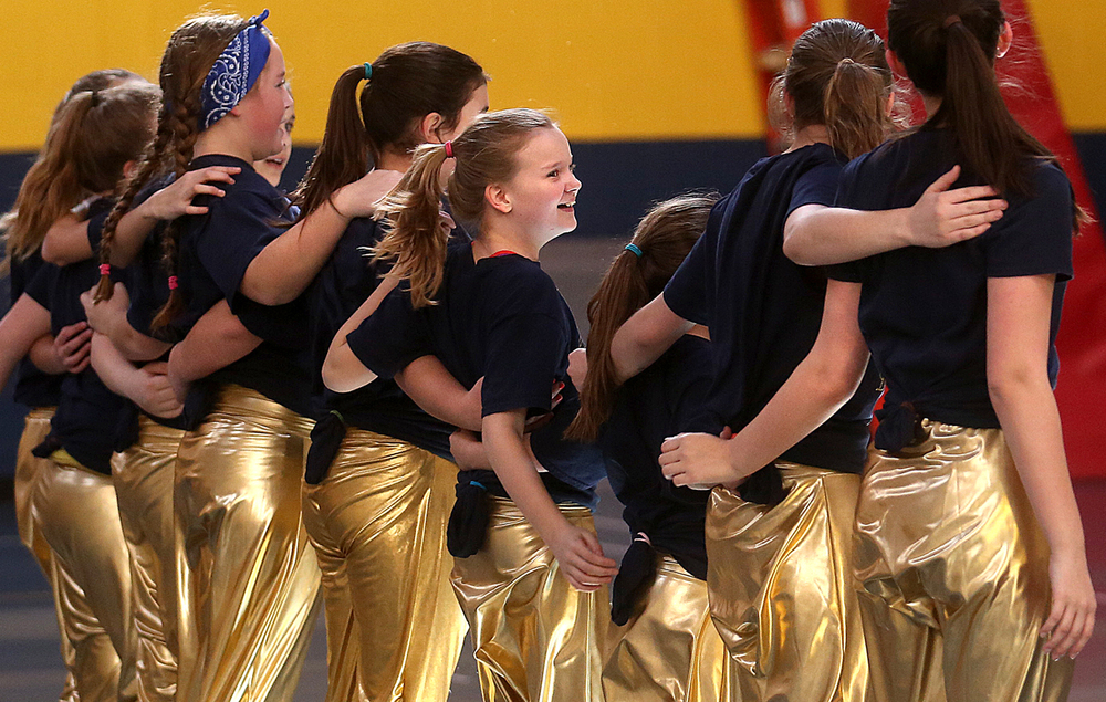 "Members of the St. Aloysius Blue Angels Dance Team finish taking a bow at the conclusion of their performance Thursday. A hip-hop dance routine with the theme of ""I Can Beat Cancer"" was performed by nine students making up the newly-formed St. Aloysius Blue Angels Dance Team during an assembly in the Springfield school's gym on Thursday, Feb. 4, 2016. Dance team member and current fifth grade student Maggie Reavis, 11, who was diagnosed with acute lymphoblastic leukemia when she was three years old and went on to successfully beat her cancer, was the inspiration for the choreography of the dance routine, which was overseen by school teachers Kim Drewes and Emily Dockter and performed Thursday as part of Catholic Schools Week. David Spencer/The State Journal Register"