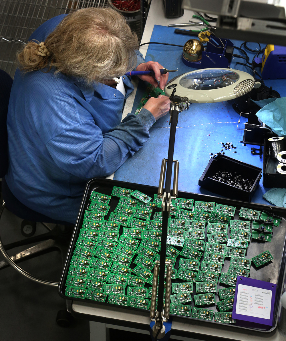 CCK employee Cheri Walton assembles circuit boards at the Jacksonville facility on Thursday, Feb. 4, 2016. CCK Automation, Inc. of Jacksonville, a company which manufactures electronic circuit boards and their housings, is a founding member of The Central Illinois Manufacturing Roundtable, a networking organization founded in early 2015 focused on industry issues such as supply-chain efficiency, quality control, risk management, international sales, employee training and marketing. David Spencer/The State Journal Register