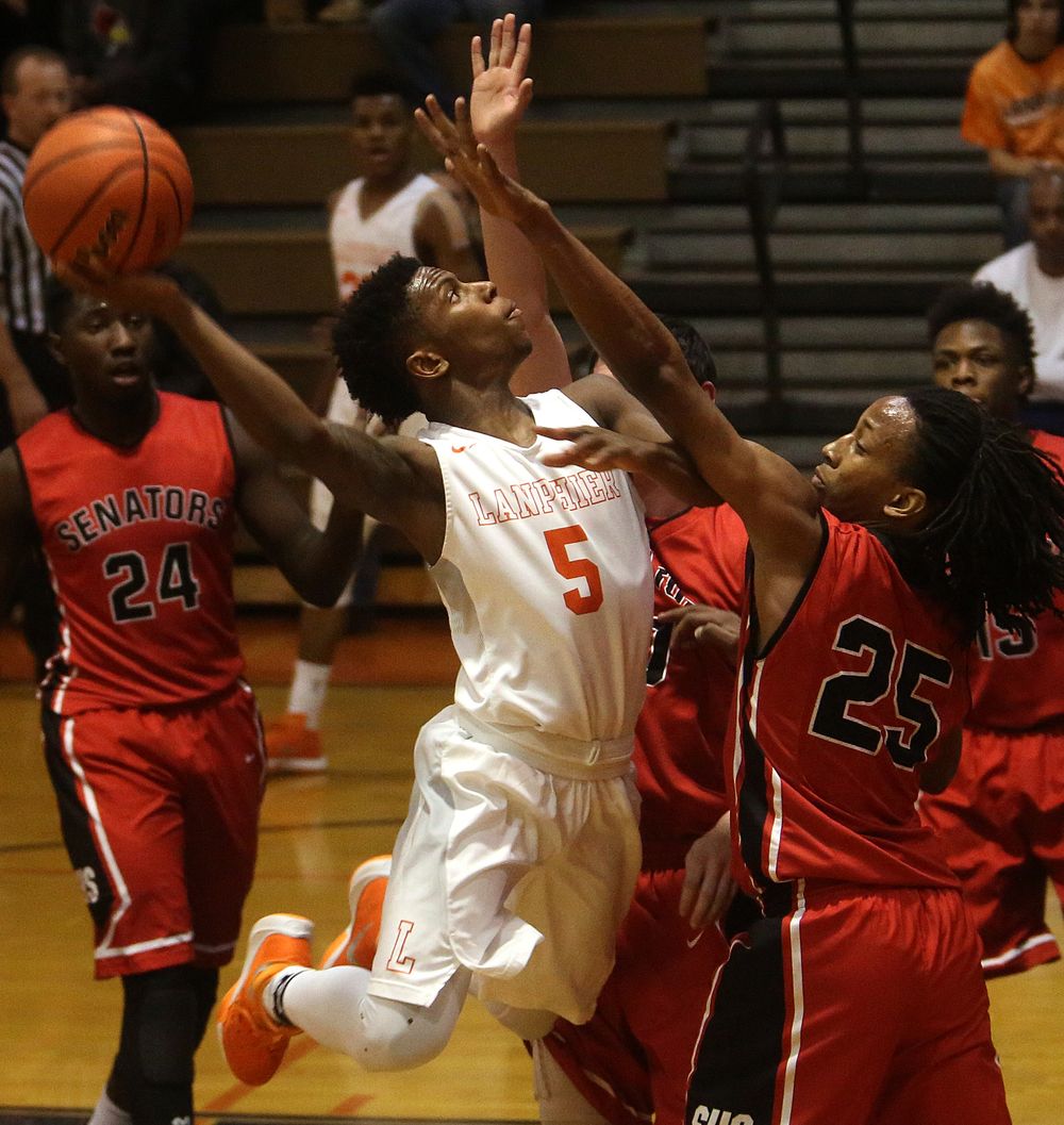 Lanphier's Xavier Bishop puts up a shot in the first half. At right is Senators defender Marquiss Johnson. David Spencer/The State Journal Register