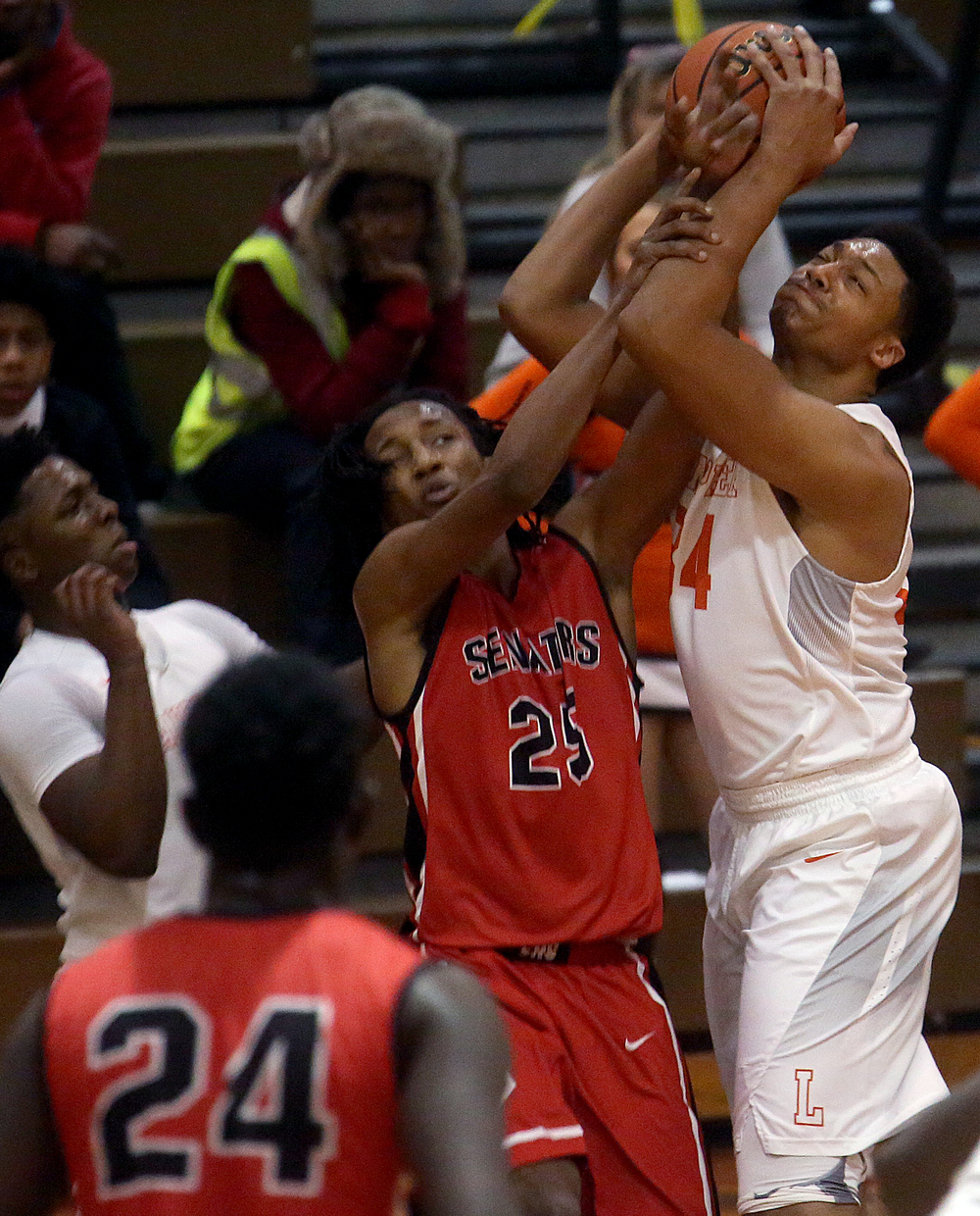 Lanphier's Davon Higgerson-Harris grabs the rebound while Senators player Marquiss Johnson defends. David Spencer/The State Journal Register
