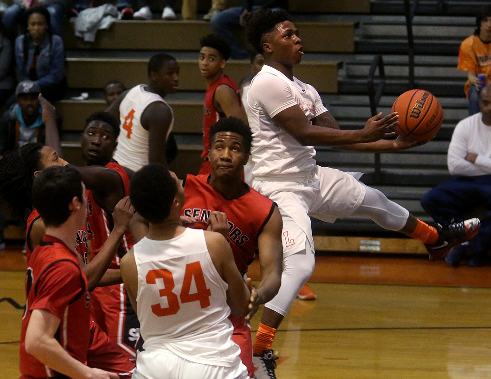 Lanphier's Xavier Bishop goes to the basket during the first half. David Spencer/The State Journal Register