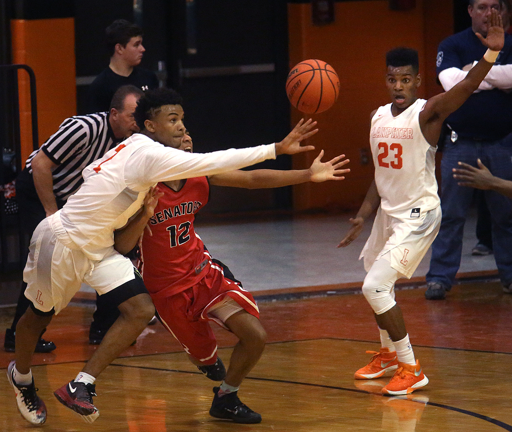 Lanphier's Cardell McGee at left fights Senators player Keon Day for control of the ball late in the first half. David Spencer/The State Journal Register