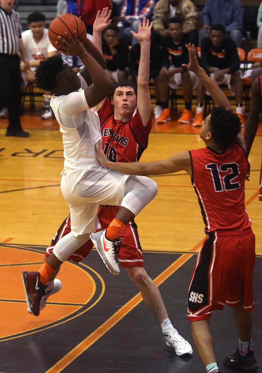 Lanphier's Xavier Bishop was very close to breaking the all-time scoring record at this point in the second half but was blocked by Senator defenders Trevor Minder at center and Keon Day. David Spencer/The State Journal Register