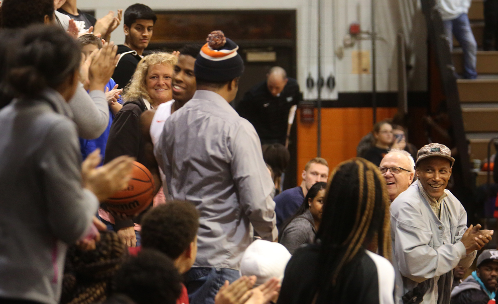 Lanphier fans cheer from the stands moments before Xavier Bishop at center personally delivered the basketball he used to score his 25th point of the game to his mom while the game was stopped momentarily to acknowledge Bishop breaking the school scoring record. David Spencer/The State Journal Register