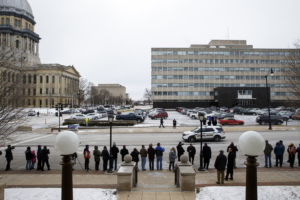 Crowds line up along Monroe Street across from the capitol and wait for President Barack Obama's arriva to speak to the legislature Wednesday, Feb. 10, 2016. Ted Schurter/The State Journal-Register