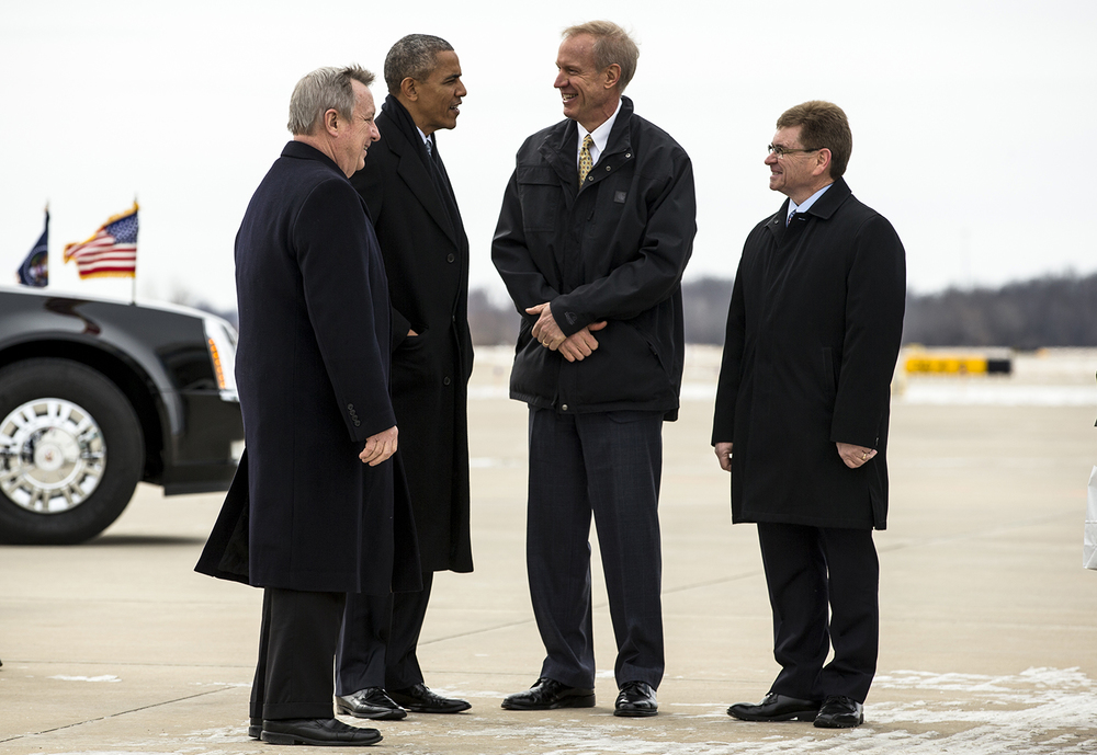 President Barack Obama visits with Illinois Gov. Bruce Rauner, center, and Springfield Mayor Jim Langfelder, right, and U.S. Senator Dick Durbin, left, after arriving on Air Force One at the Abraham Lincoln Capital Airport, Wednesday, Feb. 10, 2016, in Springfield, Ill. Justin L. Fowler/The State Journal-Register