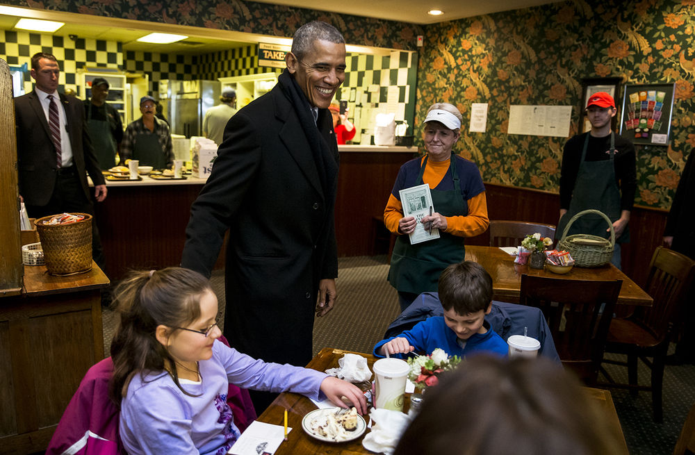 President Barack Obama visits with Anna Moser, 9, left, and her brother Grant Moser, 6, right, while stopping to order lunch at The Feed Store while on his way to the Illinois State Capitol, Wednesday, Feb. 10, 2016, in Springfield, Ill. Justin L. Fowler/The State Journal-Register