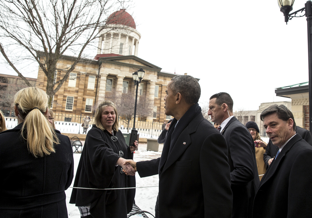 President Barack Obama stops to greet people outside of the Old State Capitol as he makes his way back to the motorcade after getting lunch at The Feed Store, Wednesday, Feb. 10, 2016, in Springfield, Ill. Justin L. Fowler/The State Journal-Register