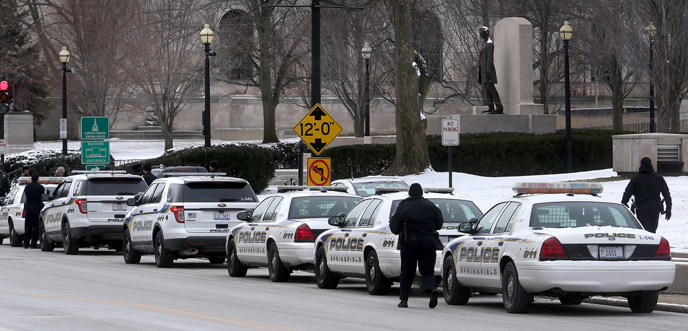 A line of Springfield police department squad cars are parked along Second St. in front of the Illinois State Capitol in Springfield on Wednesday, Feb. 10, 2016 before the arrival of President Barack Obama. David Spencer/The State Journal Register