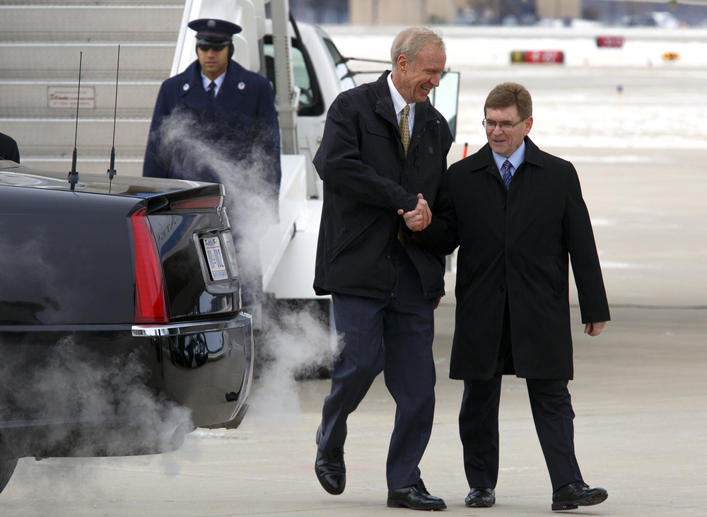 Gov. Bruce Rauner and Springfield Mayor Jim Langfelder shake hands after greeting President Barack Obama when he arrived at Abraham Lincoln Capital Airport Wednesday, Feb. 10, 2016. Rich Saal/The State Journal-Register