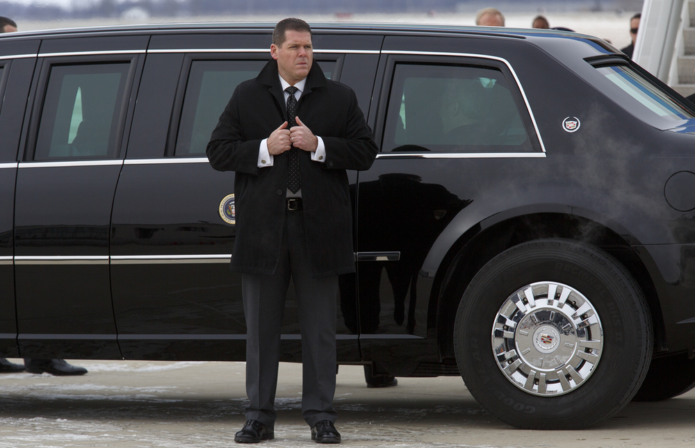 A Secret Service agent stands outside the president's limousine before the motorcade departs Abraham Lincoln Capital Airport for the Capitol Wednesday, Feb. 10, 2016. Rich Saal/The State Journal-Register
