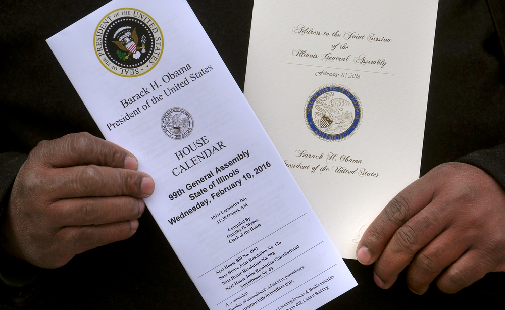 Springfield resident Douglas Holt shows off two historical keepsakes he was able to secure from President Barack Obama's speech to the Illinois General Assembly on Wednesday, Feb. 10, 2016: the official House calendar with the Presidential seal at left and a specially printed program for the President's Joint Seesion Address to the Assembly. David Spencer/The State Journal Register