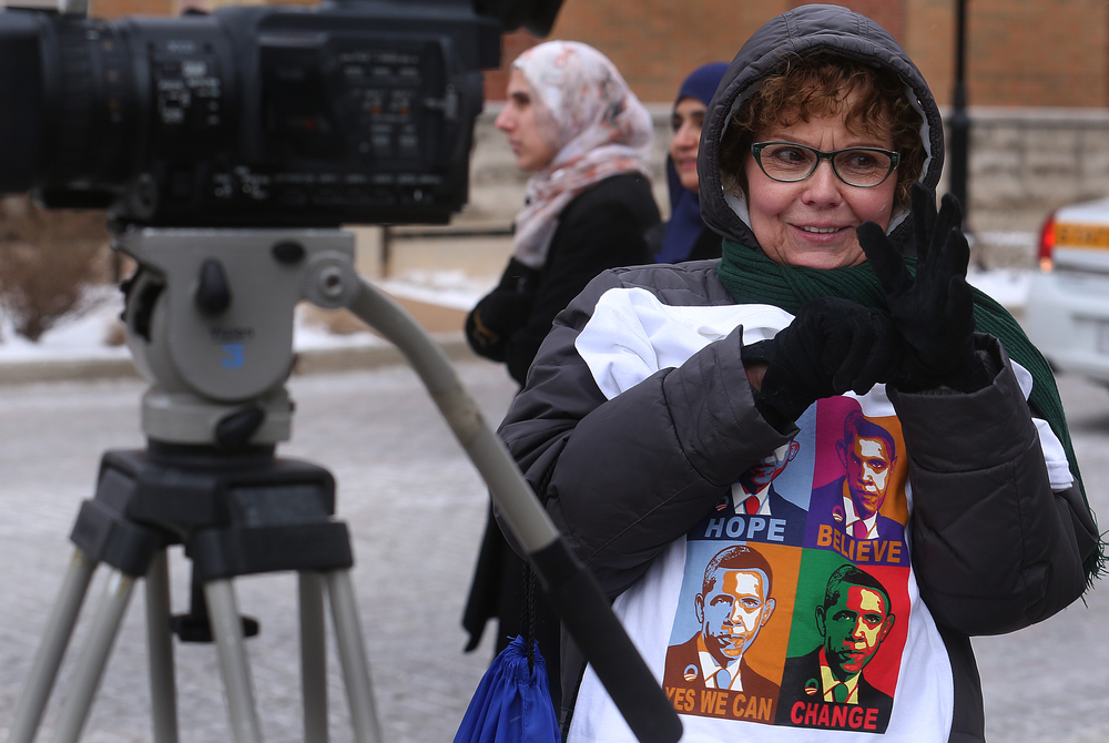 Nadine Kreft of Easton, Ill, who brought an Obama tee-shirt to show her support for the President, was trying to keep warm while adjusting her gloves while waiting for the President's motorcade to arrive at the Hoogland Center for the Arts in Springfield on Wednesday, Feb. 10, 2016.  David Spencer/The State Journal Register
