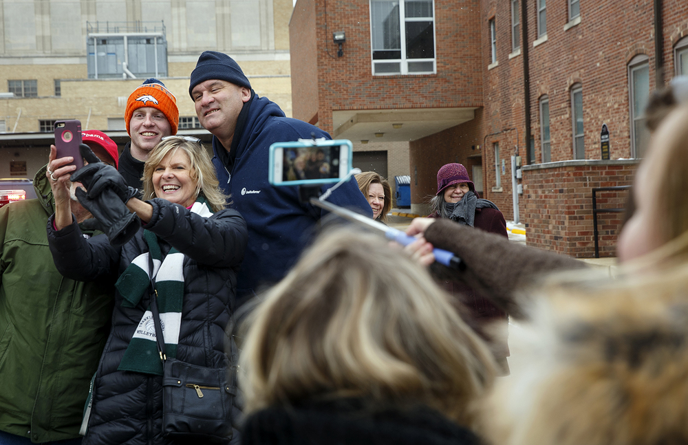 Mary Lou Dobron takes a selfie with her husband Mike, left, Brian Below and Mark Dalton as they wait to catch a glimpse of President Barack Obama on Capitol Avenue Wednesday, Feb. 10, 2016. The president was in town to speak to the Illinois legislature. Ted Schurter/The State Journal-Register