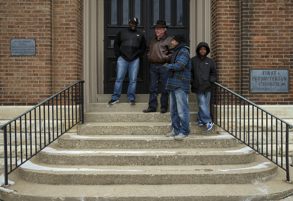 Spectators visit on the steps of First Presbyterian Church on Capitol Avenue as they wait to catch a glimpse of President Barack Obama on Capitol Avenue Wednesday, Feb. 10, 2016. The president was in town to speak to the Illinois legislature. Ted Schurter/The State Journal-Register