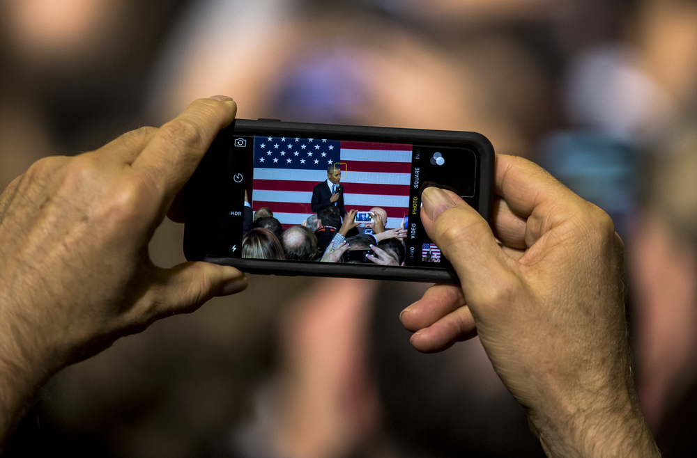 A supporter snaps a photo of President Barack Obama with a smartphone as he gives a short speech at the Hoogland Center for the Arts, Wednesday, Feb. 10, 2016, in Springfield, Ill. Justin L. Fowler/The State Journal-Register