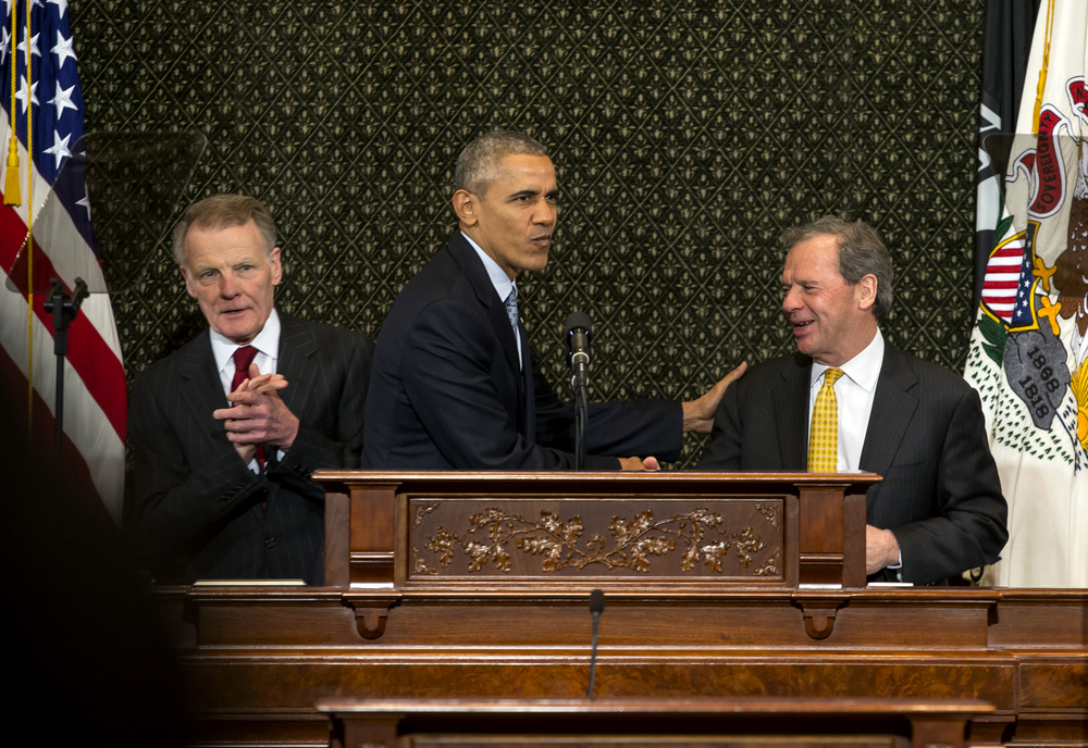 President Barack Obama is greeted by Illinois Speaker of the House Michael Madigan and Illinois Democratic Senate President John Cullerton as takes the podium to deliver a speech to a joint session of the Illinois General Assembly in the Illinois House chambers at the Illinois State Capitol, Wednesday, Feb. 10, 2016, in Springfield, Ill. Justin L. Fowler/The State Journal-Register