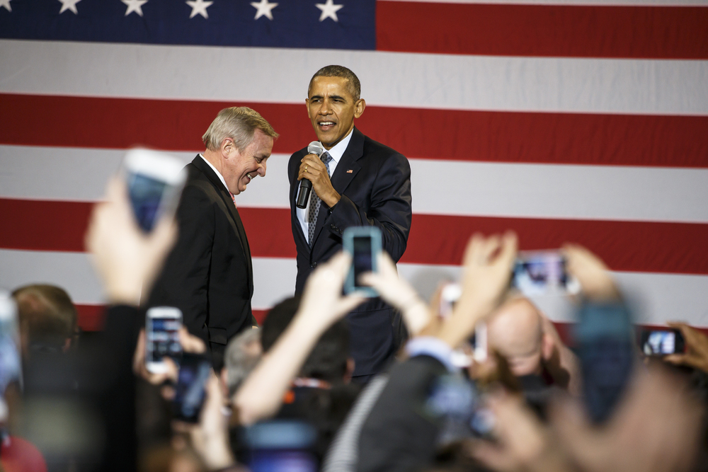 President Barack Obama takes the microphone after being introduced by Sen. Dick Durbin, left, to deliver a speech to supporters at the Hoogland Center for the Arts, Wednesday, Feb. 10, 2016, in Springfield, Ill. Justin L. Fowler/The State Journal-Register
