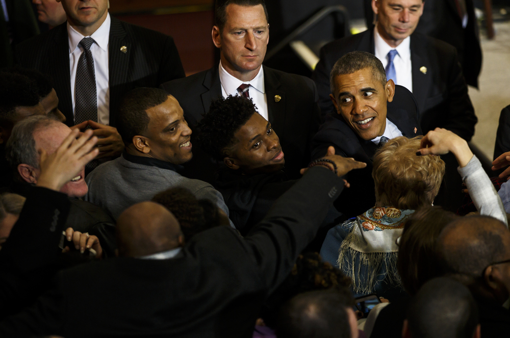 President Barack Obama reaches out to shake hands with supporters, including Lanpheir head boys basketball coach Blake Turner, left, and Yakeema Rose, center, after finishing a short speech at the Hoogland Center for the Arts, Wednesday, Feb. 10, 2016, in Springfield, Ill. Justin L. Fowler/The State Journal-Register