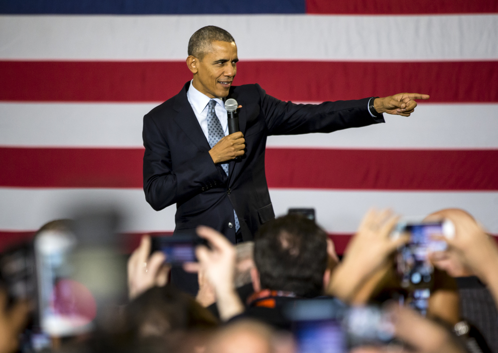 President Barack Obama greets supporters as he takes the stage at the Hoogland Center for the Arts to deliver a short speech, Wednesday, Feb. 10, 2016, in Springfield, Ill. Justin L. Fowler/The State Journal-Register