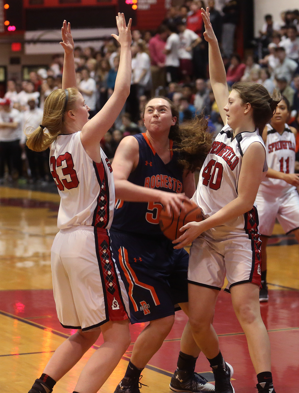 Rochester's Angela Perry is boxed in by Springfield defenders Ellie Brandt at left and Abby Ratsch. David Spencer/The State Journal Register