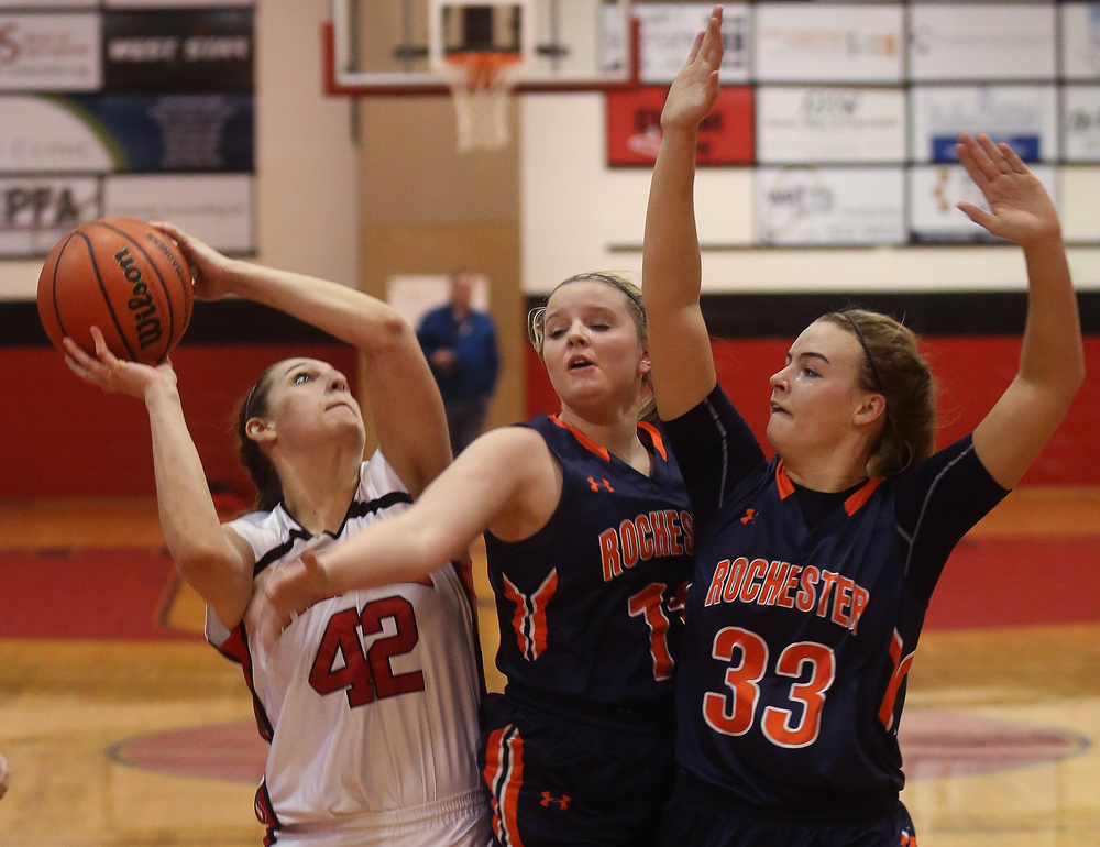 Springfield's Nicole Swehla tries to put up a shot under pressure from Rochester defenders Kylie Clemens in middle and Meagan McNicholas. David Spencer/The State Journal Register