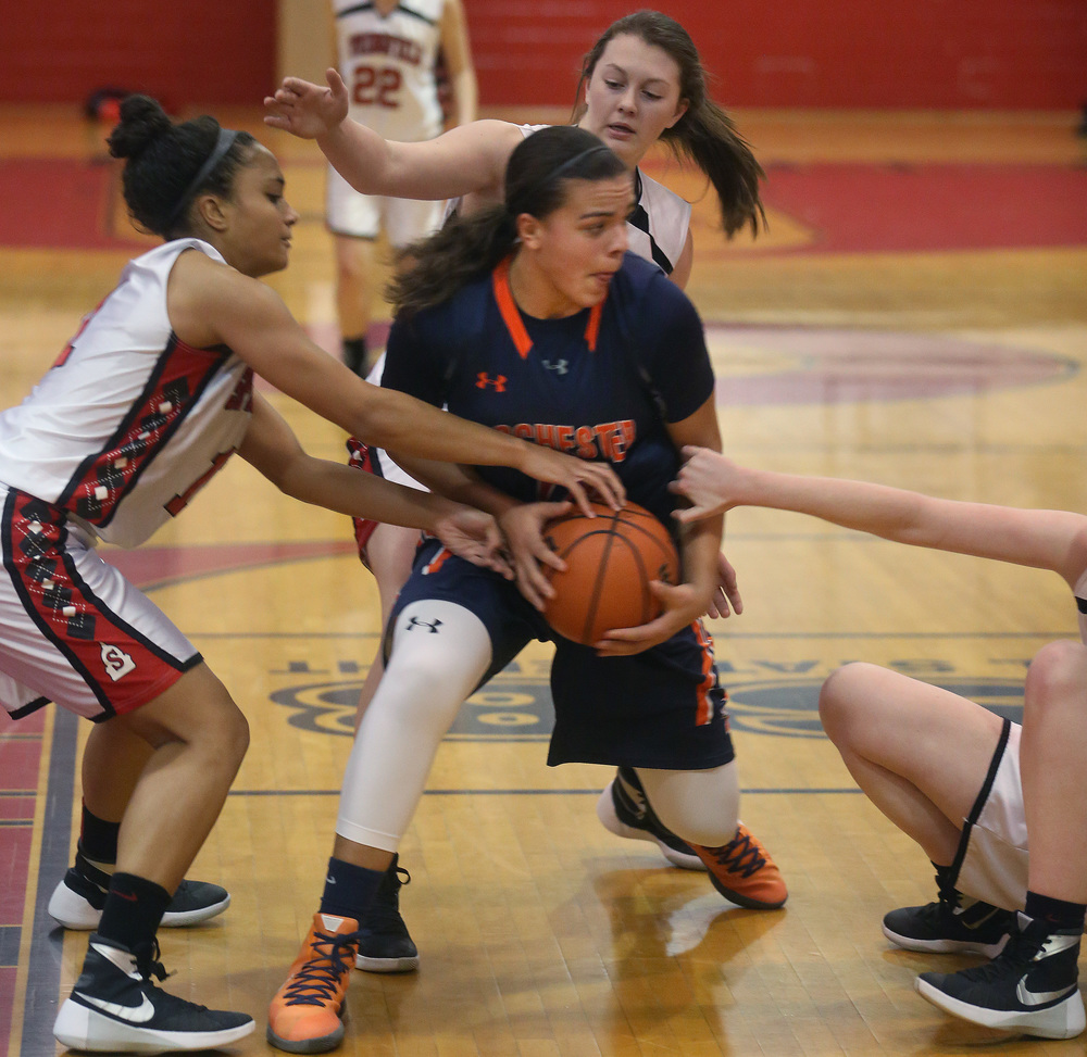 Rochester's Lyric Boone tries to hold onto the ball while looking for an opening while being defended by Springfield player Kyra Webster at left. David Spencer/The State Journal Register