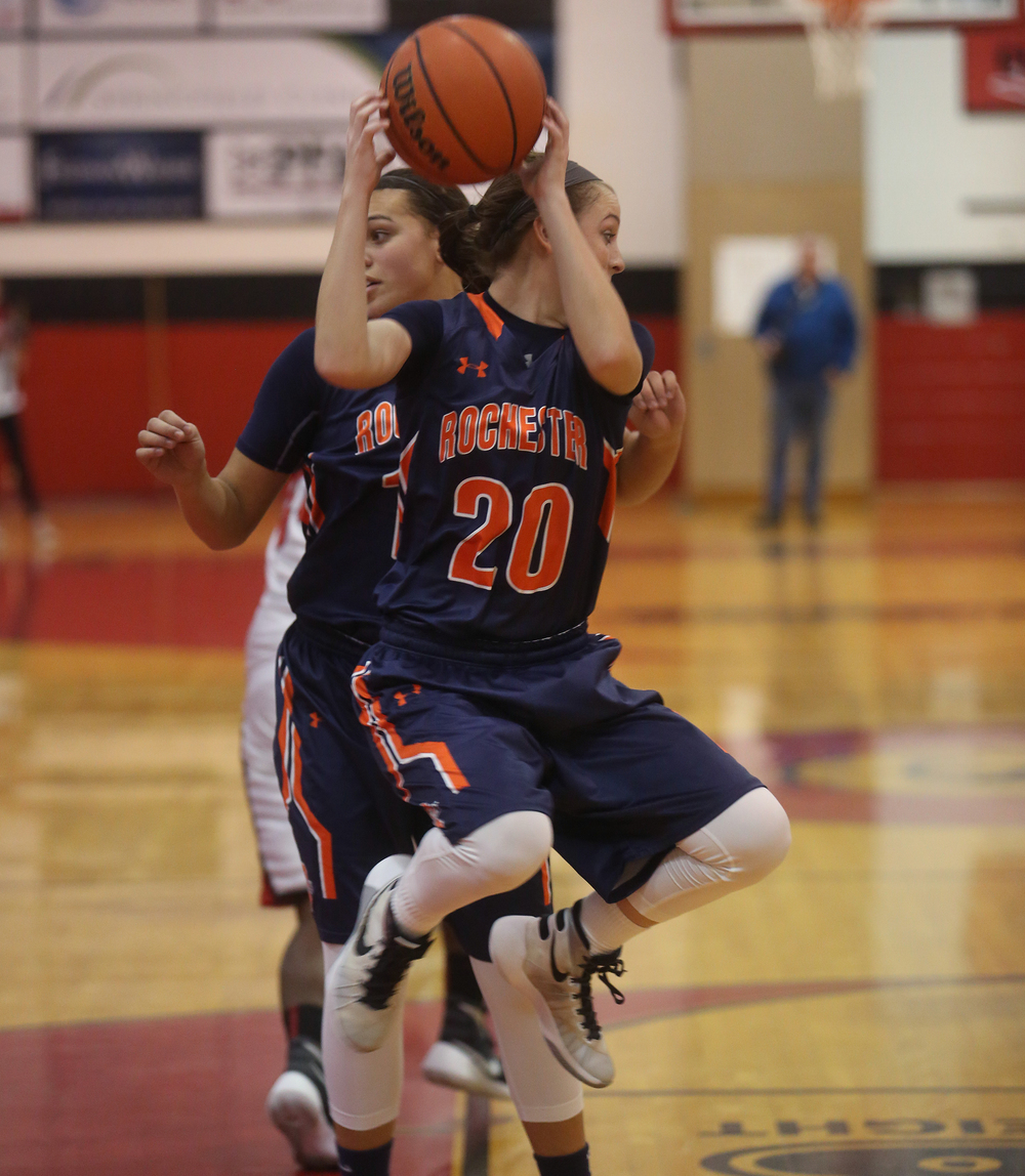 Rochester's Aubrey Magro pulls down a rebound. David Spencer/The State Journal Register