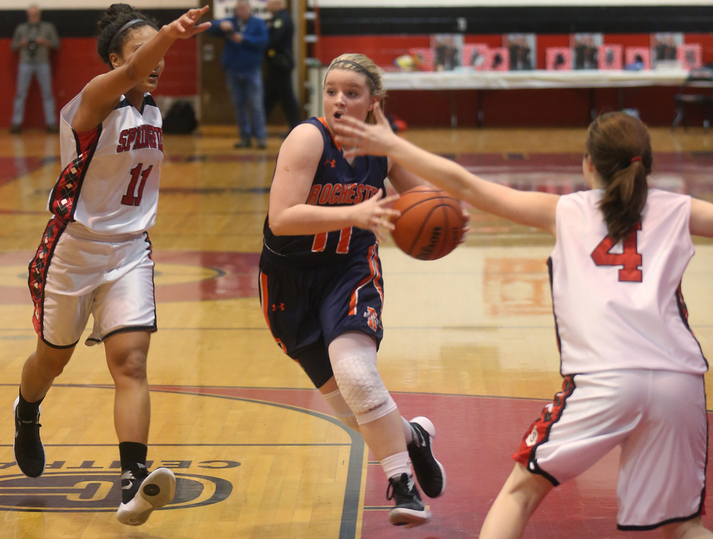 Rochester's Kylie Clemens drives through Springfield defenders Kyra Webster at left and Brooklyn Crum. David Spencer/The State Journal Register