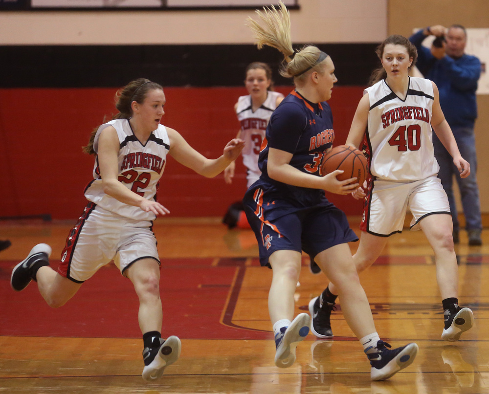 Rochester'sMadison Faulkner puts the brakes on with the ball while being pursued by Springfield player Sarah Cross at left. David Spencer/The State Journal Register