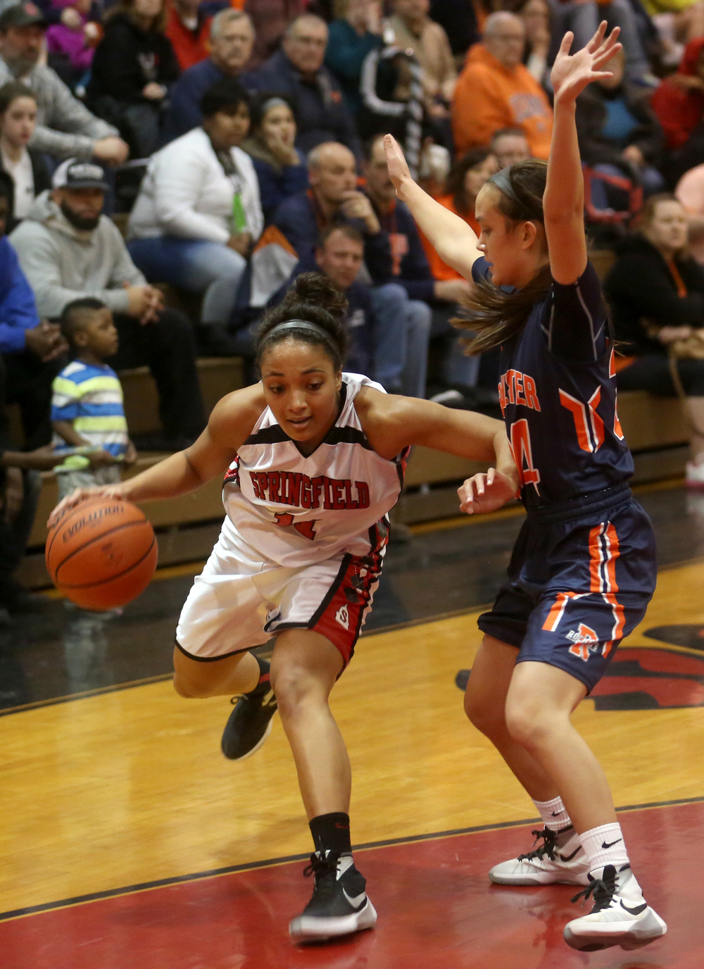 Springfield's Kyra Webster drives around Rochester's Nicole Robinson. David Spencer/The State Journal Register