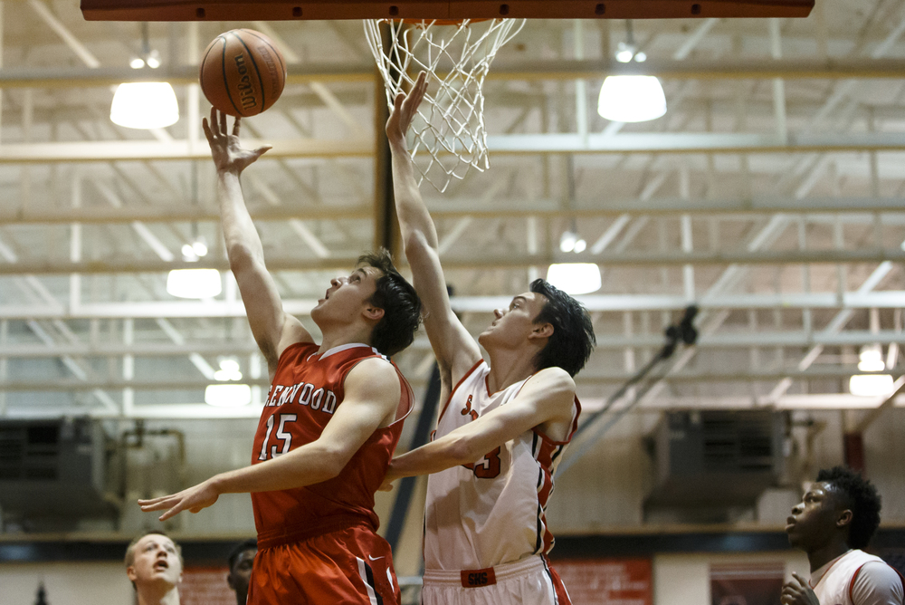 Glenwood's Joel Alexander (15) goes up an attempt underneath the basket against Springfield's Ethan Klay (23) in the first quarter at Willard Duey Gymnasium, Friday, Feb. 12, 2016, in Springfield, Ill. Justin L. Fowler/The State Journal-Register