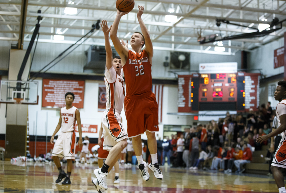 Glenwood's Parker Allen (22) goes up for a basket against Springfield's Trevor Minder (10) in the first quarter at Willard Duey Gymnasium, Friday, Feb. 12, 2016, in Springfield, Ill. Justin L. Fowler/The State Journal-Register