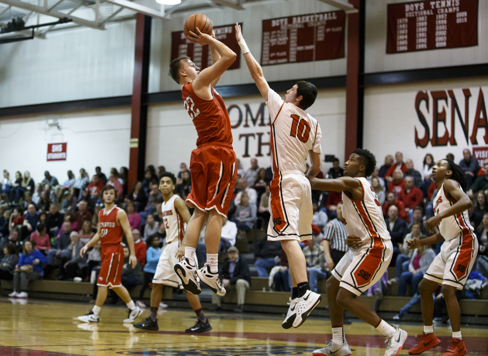 Glenwood's Parker Allen (22) fires a jumper over Springfield's Trevor Minder (10) in the second quarter at Willard Duey Gymnasium, Friday, Feb. 12, 2016, in Springfield, Ill. Allen led the Titans in scoring with 26 points in their 59-41 victory over Springfield. Justin L. Fowler/The State Journal-Register