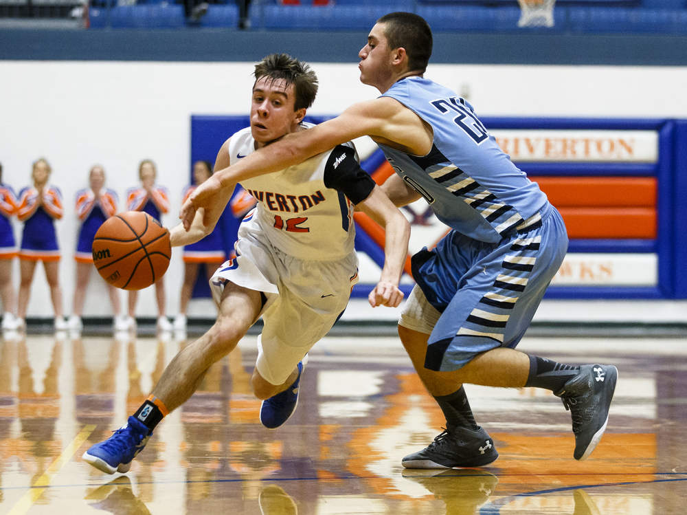 Riverton's Ryan Roscetti (12) collides with St. Elmo's Klayton Kroll (20) drawing the foul as he drives towards the basket in the second quarter during the Riverton Subway Shootout at Riverton High School, Saturday, Feb. 13, 2016, in Riverton, Ill. Justin L. Fowler/The State Journal-Register