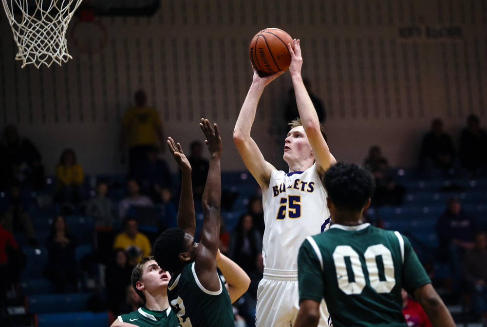 Williamsville's Harrison Cresswell (25) shoots a jumper over Metro-East Lutheran's Darion Brooks (2) in the fourth quarter during the Riverton Subway Shootout at Riverton High School, Saturday, Feb. 13, 2016, in Riverton, Ill. Justin L. Fowler/The State Journal-Register