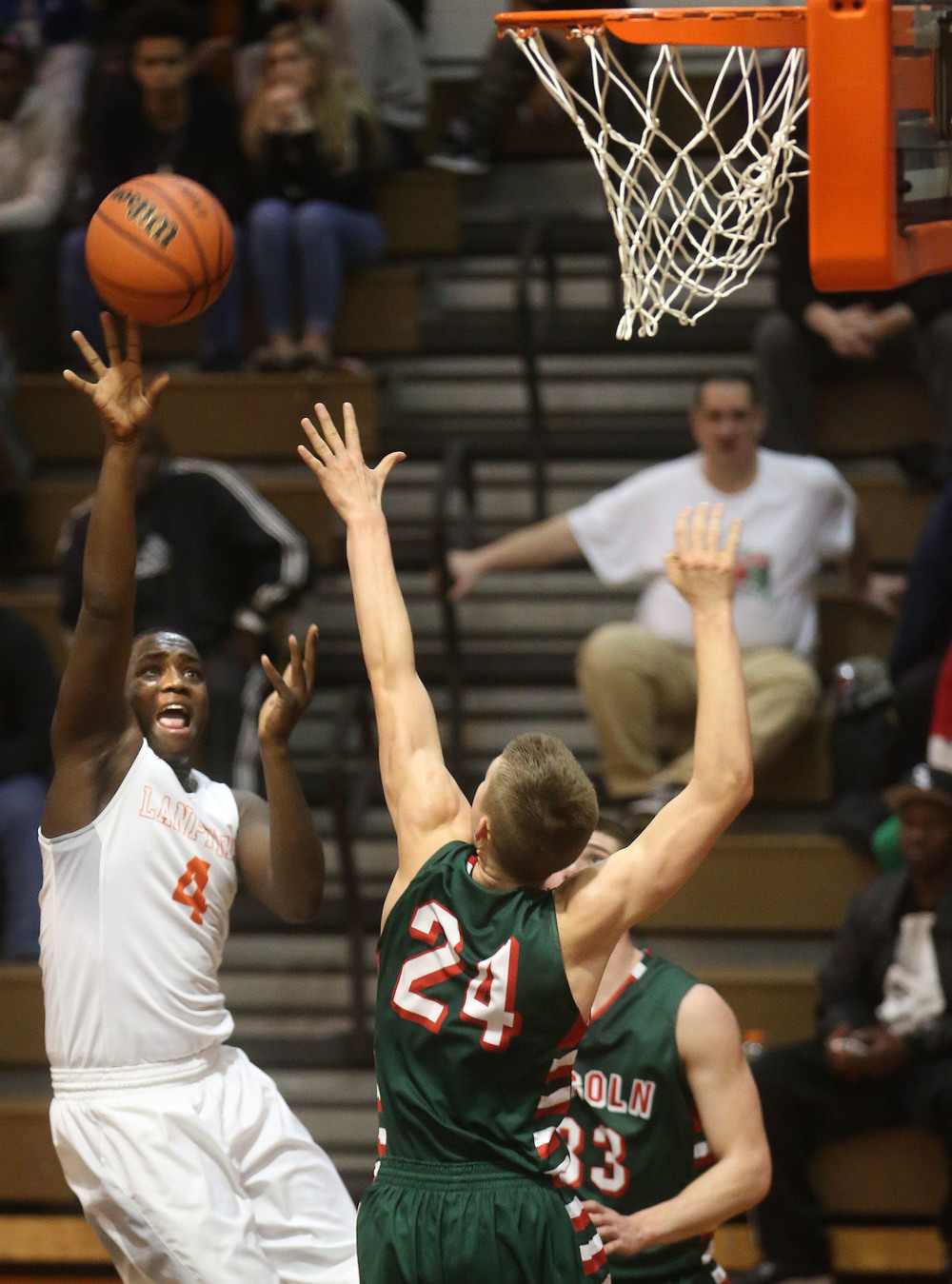 Lanphier's Corrington Jones shoots over Lincoln player Ben Grunder. David Spencer/The State Journal Register