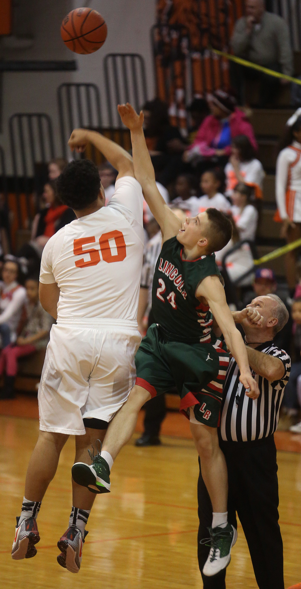 The opening tipoff featured Lanphier's William Boles at left and Lincoln's Ben Grunder. David Spencer/The State Journal Register