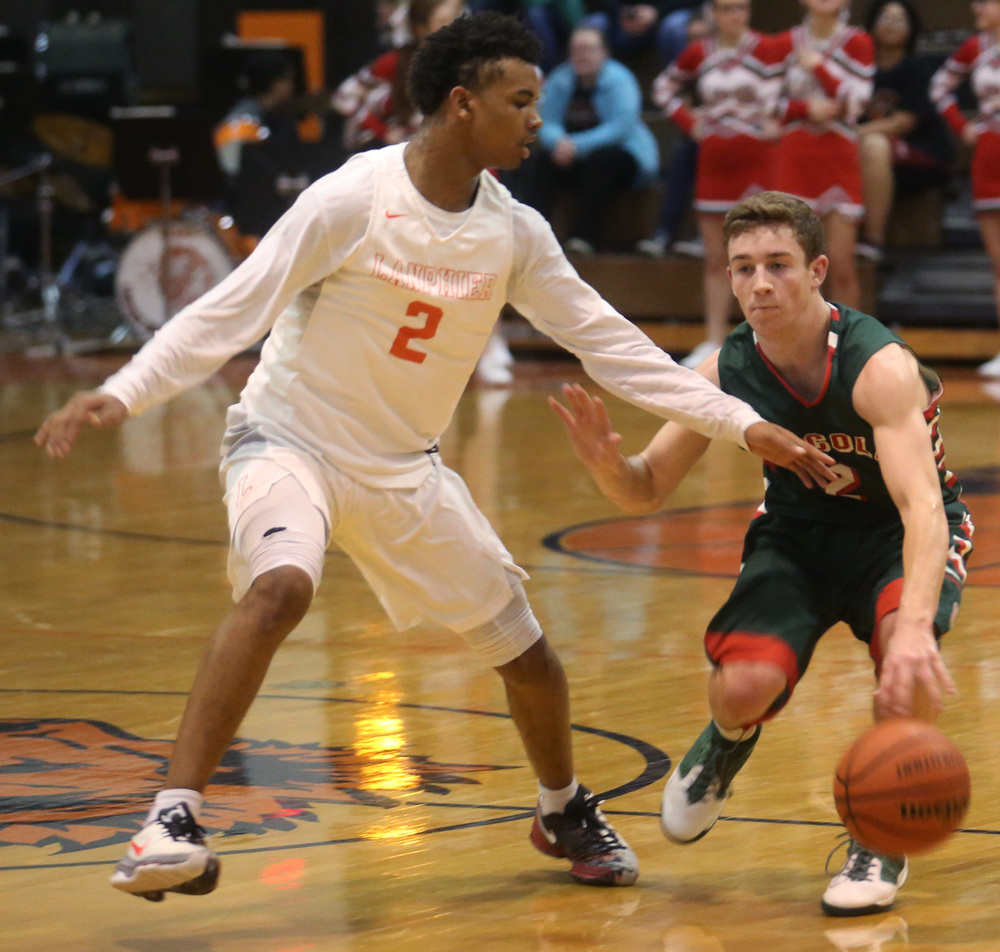 Lanphier player Cardell McGee defends against Lincoln player Garrett Aeilts. David Spencer/The State Journal Register