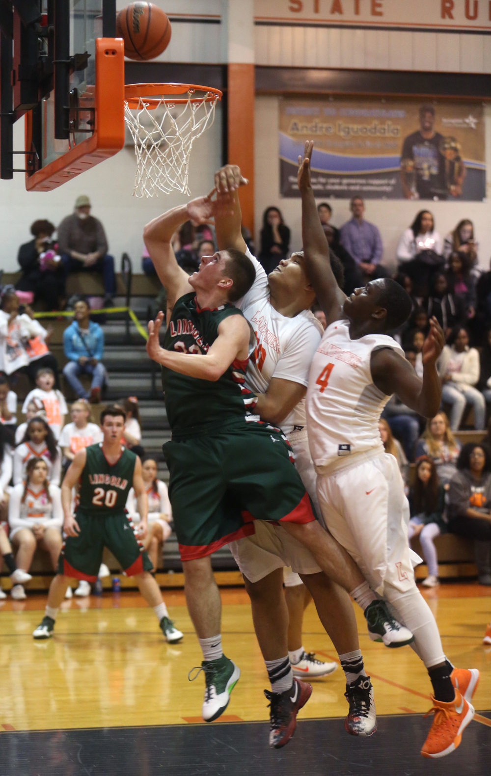 A rebound gets the attention of Lincoln player Isaiah Bowers at left and Lanphier players William Boles at center and Corrington Jones. David Spencer/The State Journal Register