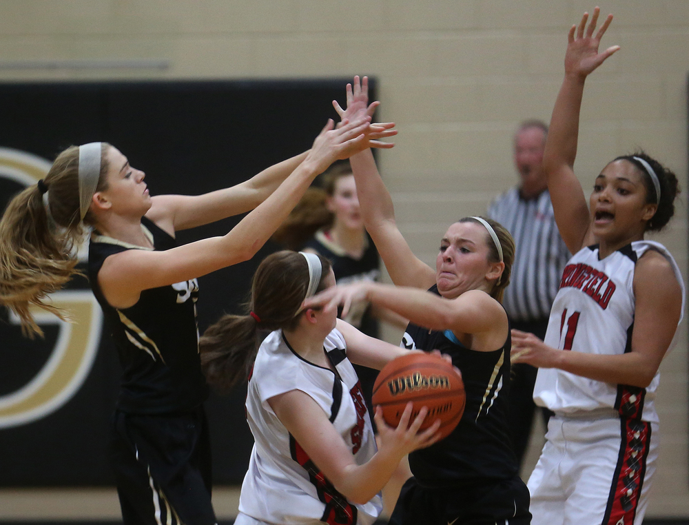 Senators player Brooklyn Crum tries to get the ball to teammate Kyra Webster at far right as SHG player Katie McLean defends at center.  David Spencer/The State Journal Register