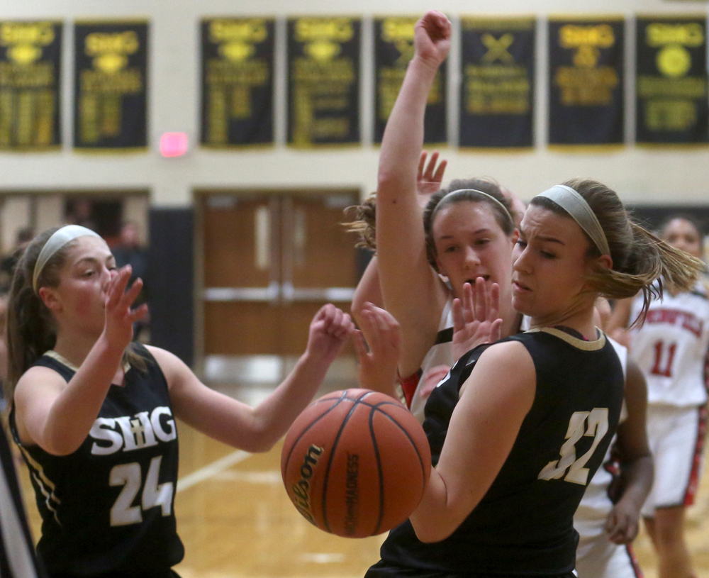 SHG player Julie Staten at front right watches a loose ball made by a shot by Springfield's Sarah Cross.  David Spencer/The State Journal Register