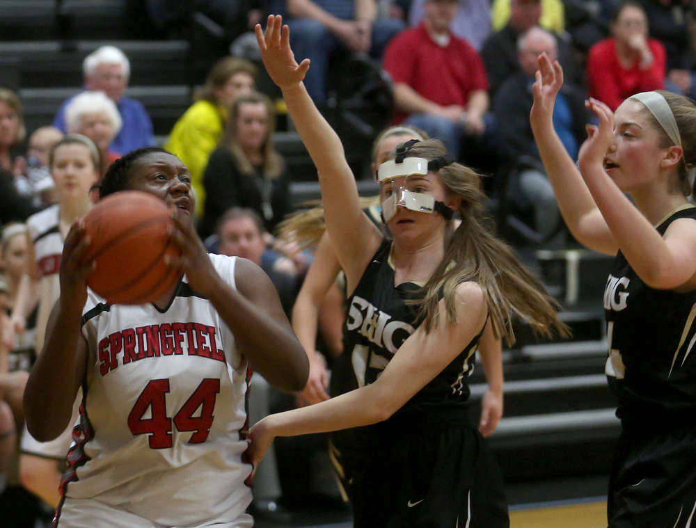 Springfield's Montshianna Pulliam puts up a shot during the first half while SHG player Payton Vorreyer defends at middle. David Spencer/The State Journal Register