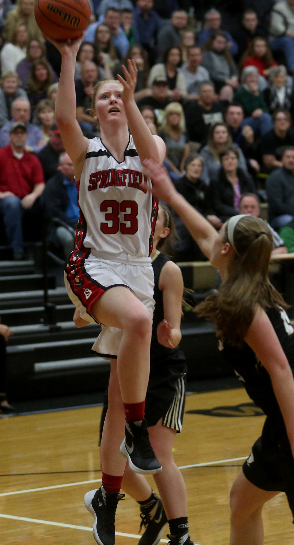 Springfield's Ellie Brandt puts up two points during the first half.  David Spencer/The State Journal Register