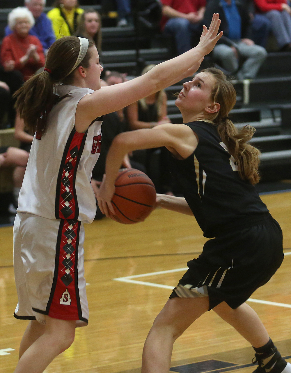 SHG player Lakyn Wagoner looks to make a shot while Springfield's Brooklyn Crum defends at left. David Spencer/The State Journal Register