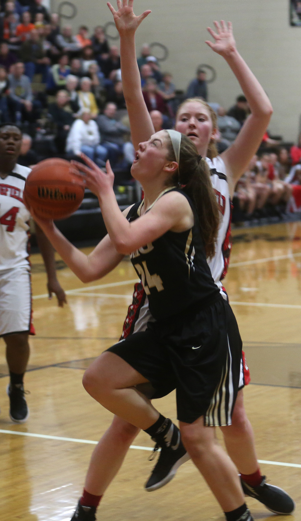 SHG player Anna Lowis prepares to make a shot in the second half. David Spencer/The State Journal Register